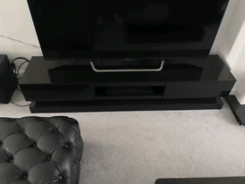Fabulous long high gloss black TV unit with LED Lights
