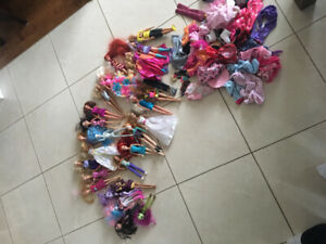 25 Barbie And Lil Bratz Dolls with clothes