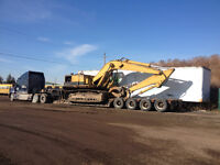 We Relocate, deliver and also  buy and pick up heavy equipment !
