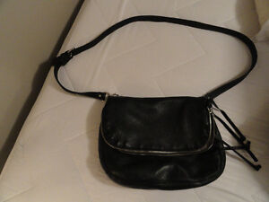 Roots black leather purse.