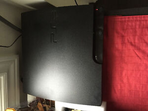 Great Condition PS3 with 3 Controllers and 5 Games