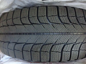 205/65R15 Michelin X-Ice winter tires with steel rims