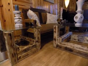 very rustic coffee and end tables, glass top