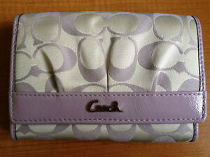 BRAND NEW COACH medium sized wallet with the Signature C's