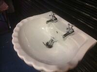 Sink pedestal and taps