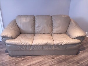 Genuine leather tan love seat and sofa.