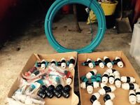 Plasson water fittings and 25 met roll of water pipe