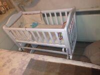White, amazing quality swinging crib