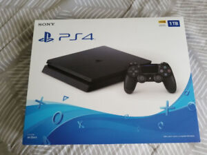 PS4 Slim 1TB (Latest & Almost new) Plus games & Headsets (Avai..