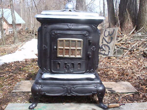 Antique Parlor Stove wood stove  all cast iron