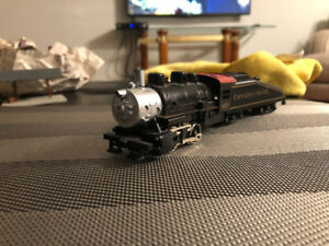 HO-Scale Model Train Engines And Cars