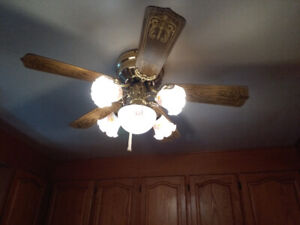 Ceiling Fan with 4 Hurricane Lights and Large Light Works Great