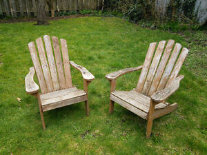 * Two Weathered Wooden Adirondack Chairs *