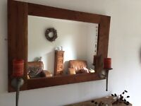 Rustic mirror with candle sconces
