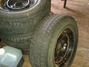 Cooper Artic Claw studded snow tires on Ford rims