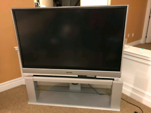 "60"" Panasonic HD TV for sale with the table"