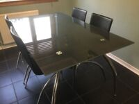 Glass dining Table & 4 Faux Leather Chairs