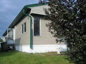 AIRDRIE MOBILE HOME and LAND INCLUDED  ON HUGE LOT