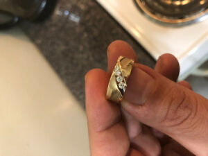 Men's 10 karat gold ring with three diamonds . Size 6