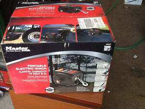 Master lock electric 2000lb. 12 volt D.C. New winch