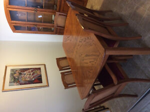 Real nice table and china cabinet for sale..