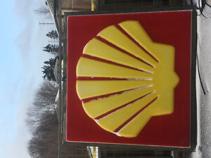 Two vintage shell signs