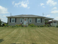 Neat one storey bungalow on a third of an acre.