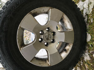 4- 235/70/R16 on Factory Nissan Pathfinder rims Prince George British Columbia image 2