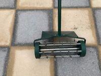 Lawn scarifier.