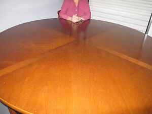 Hand-crafted teak round dining table and six matching chairs