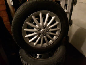215 55 16 Gislaved Nord Frost tires steel rims and hubcaps