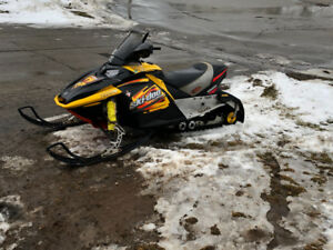Snowmobile and trailer