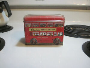 Vintage double decker bus and Harrods candy tins