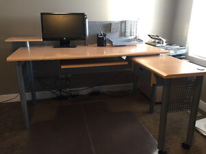 Desk, office chair, and filing cabinet with drawer