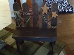 Wood bench with grapevine and wood stars and welcome sign