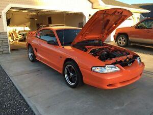 1996 Ford Mustang orange Coupe (2 door)