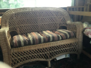 Wicker love seat with cushon