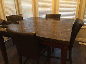 Marble table and 4 leather chairs