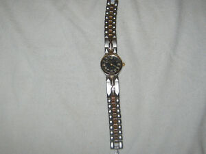 Kabana ladies gold and silver watch
