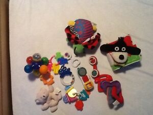 Various toys, rattles and teethers and 2 soft and tactile books