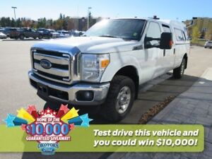 2015 Ford F-250 Super Duty XLT  Topped truck with extended bed,