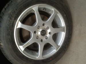 """4 14"""" Core racing rims with P175/65/R14 tires."""