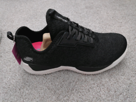 Brands new boxed ladies skechers trainers black size 4