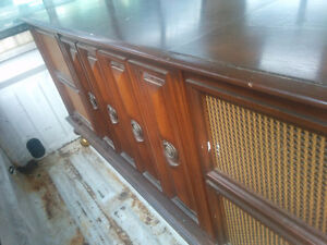 Free record player in cabinet