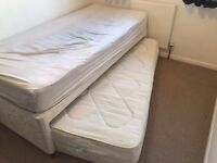 Single bed with guest trundle bed underneath