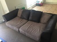 Black faux leather and material sofa