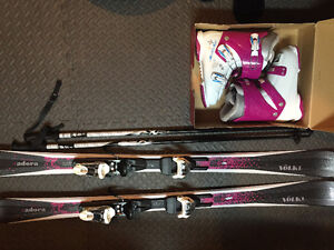 Brand new women's Down Hill Ski's with poles & boots