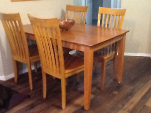 Oak dinning table(with leaf extension to seat 8-10)4 chairs.