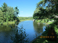 Upper Sturgeon River lot, in town,198 ft deep