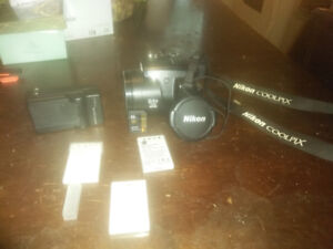 Nikon Coolpix P90 with 3 batteries charger and 32GB sd card